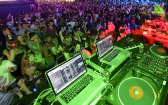 A DJ performs on stage as festival goers dance in the 'Silent Disco' at the 'Music, in the Park' stage, during the 50th Montreux Jazz Festival, in Montreux, Switzerland, 09 July 2016. The music festival runs from 01 to 16 July. ANSA/ANTHONY ANEX EDITORIAL USE ONLY