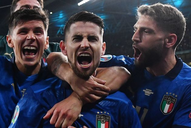 Italy's midfielder Jorginho (C) celebrates with teammates after winning the UEFA EURO 2020 semi-final...